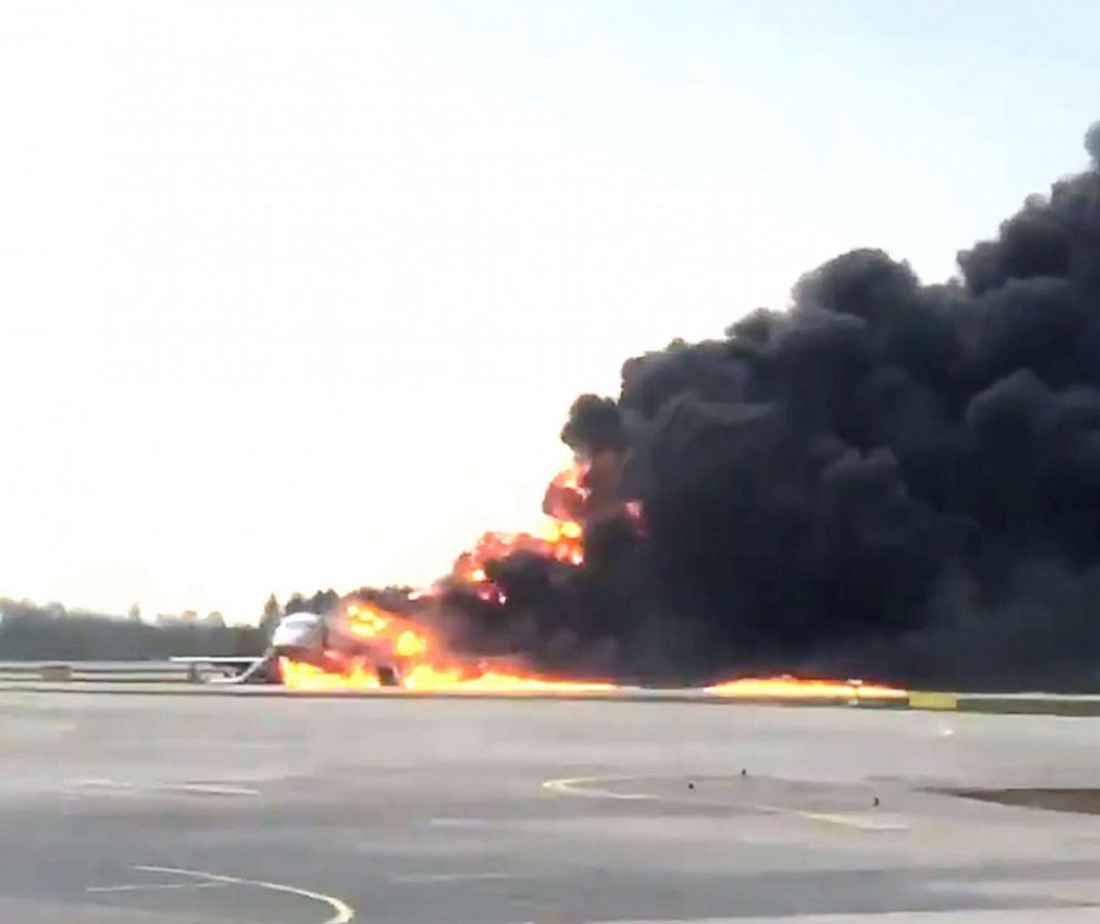 PHOTO: In this image provided by Norenko Mikhali shows smoke rises from a fire on a plane at Moscows Sheremetyevo airport on Sunday, May 5, 2019.