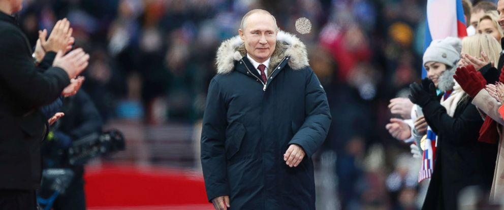 PHOTO: Russian President Vladimir Putin arrives to attend a massive rally in his support as a presidential candidate at the Luzhniki stadium in Moscow, Russia, March 3, 2018.