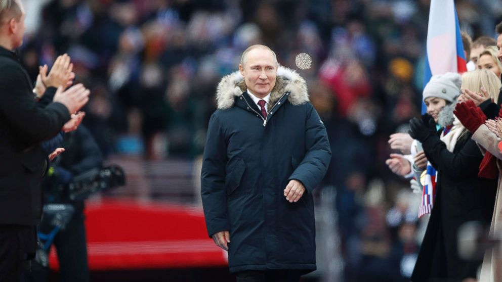 Hasil gambar untuk Vladimir Putin speaks during a campaign concert as supporters at Luzhniki Stadium on March 3, 2018 in Moscow