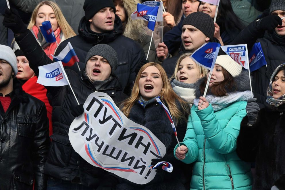 PHOTO: Supporters of presidential candidate, President Vladimir Putin attend a pre-election rally at the Luzhniki stadium in Moscow, March 3, 2018. The placard reads Putin is the best!.