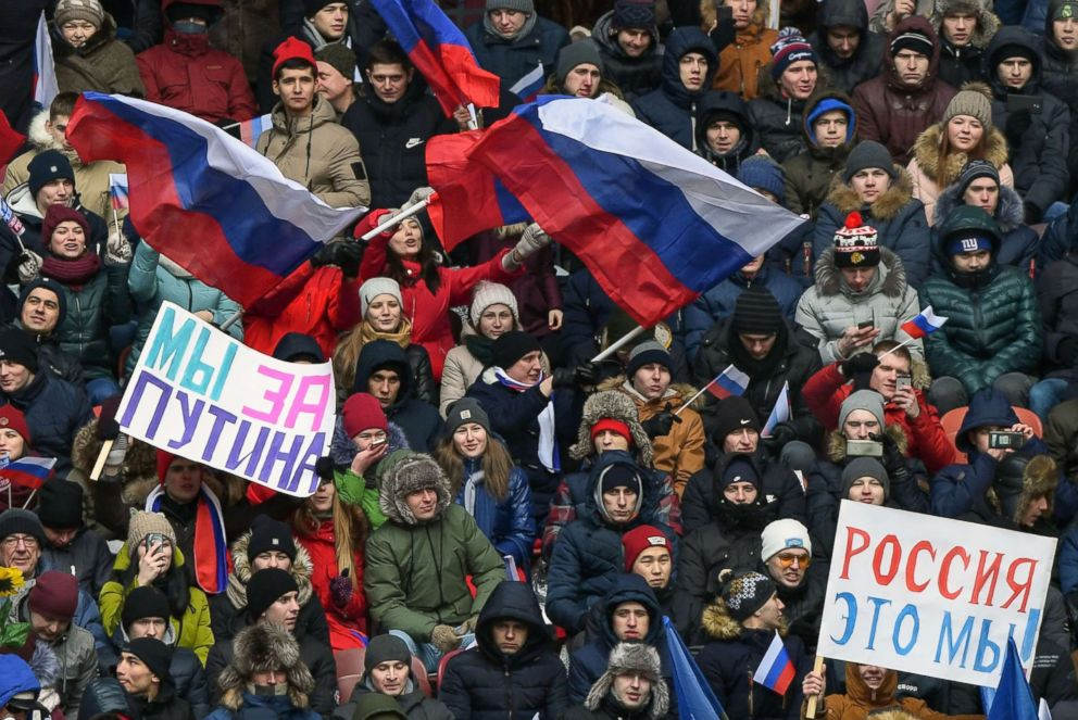 PHOTO: Supporters of presidential candidate, President Vladimir Putin gather for a pre-election rally at the Luzhniki stadium in Moscow, March 3, 2018.
