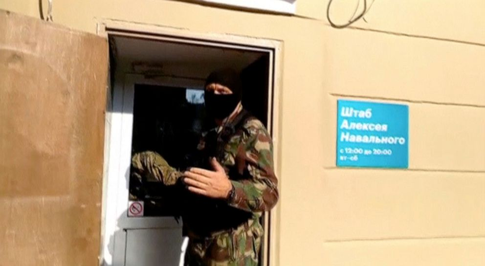 PHOTO: A masked law enforcement officer addresses journalists during a raid in a local office of Kremlin critic Alexei Navalny in Perm, Russia, Sept. 12, 2019, in a still image taken from a video.