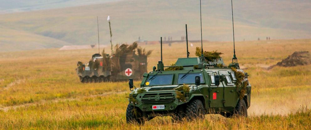 PHOTO: Chinese military vehicles through a field in Chita, Eastern Siberia, during the Vostok 2018 exercises, Sept. 11, 2018.