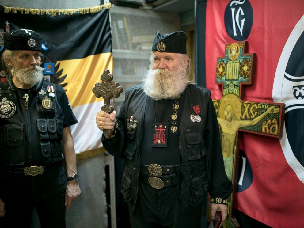 PHOTO: Leonid Simonovich-Nikshich, right, head of the Union of Orthodox Banner-Bearers, and Igor Miroshnichenko, his deputy, prepare for the award ceremony at their headquarters in Moscow, July 12, 2018.