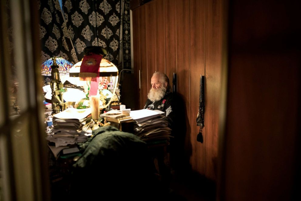 PHOTO: Leonid Simonovich-Nikshich, the head of Orthodox Banner Bearers, works on an article in his office at his home in Moscow, July 19, 2018.