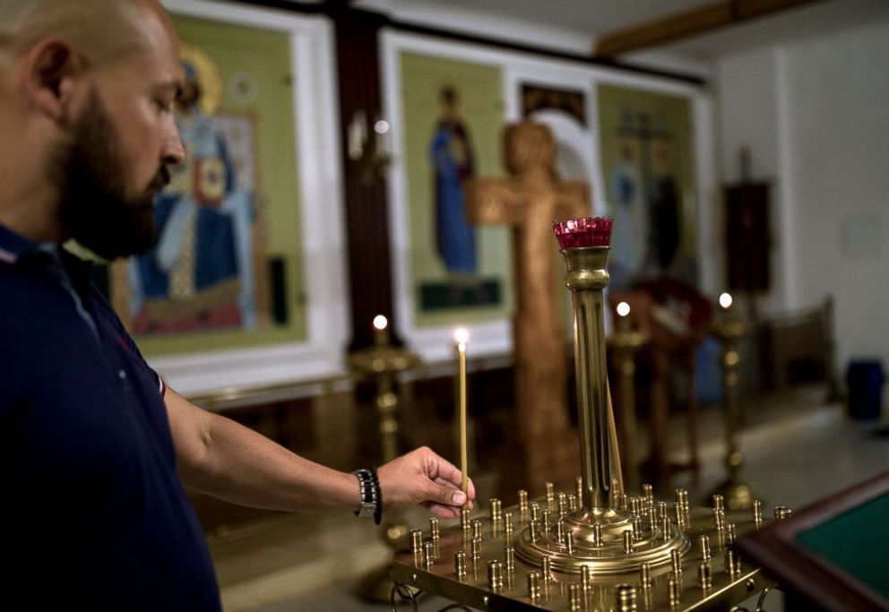 PHOTO: Denis, a member of the Union of Orthodox Banner-Bearers, visits the church inside TV and Radio Broadcasting Centre Ostankino where he works, during a break, in Moscow, July 18, 2018.