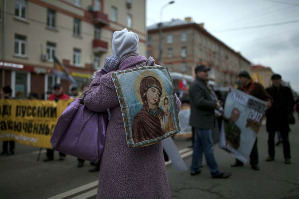 PHOTO: A woman with an image of Virgin Mary on her back attends a march of the Unity of Nation in Oktyabrskoye Polye in Moscow, Russia, Nov. 4, 2017.