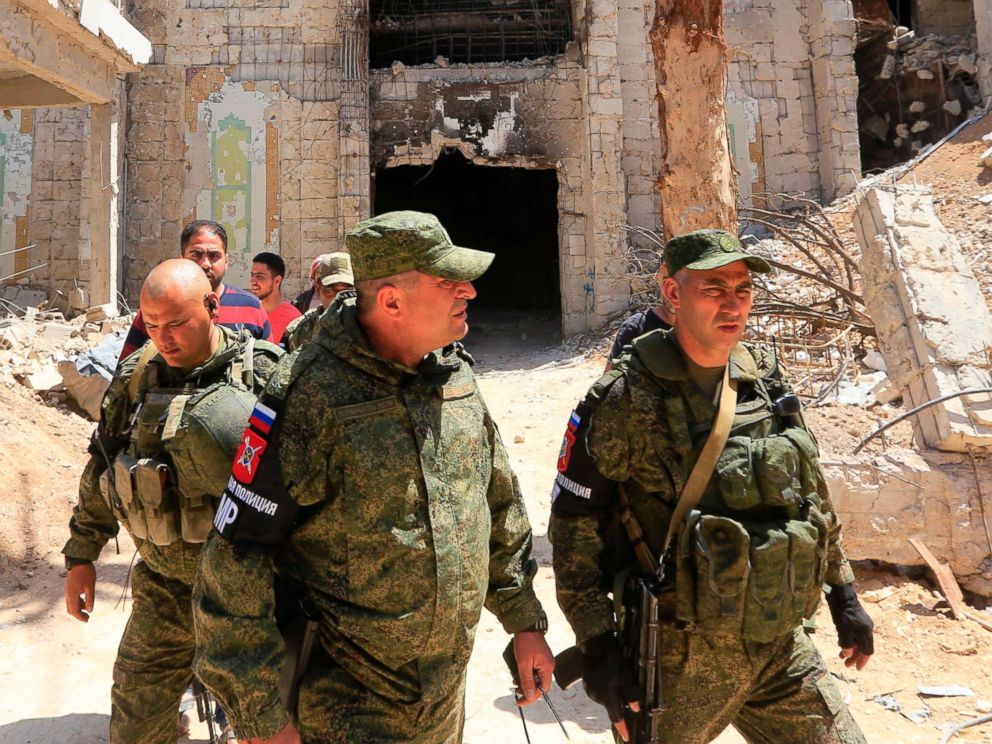 PHOTO: Russian forces patrol damaged buildings in Douma, Syria on the outskirts of Damascus, April 16, 2018, during an organised media tour after the Syrian army declared that all anti-regime forces have left Eastern Ghouta.