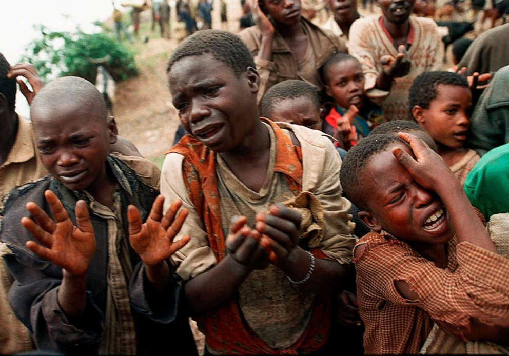 PHOTO: Rwandan refugee children plead with Zairean soldiers to allow them across a bridge separating Rwanda and Zaire where their mothers had crossed moments earlier before the soldiers closed the border, in Zaire, now known as Congo, Aug. 20, 1994.