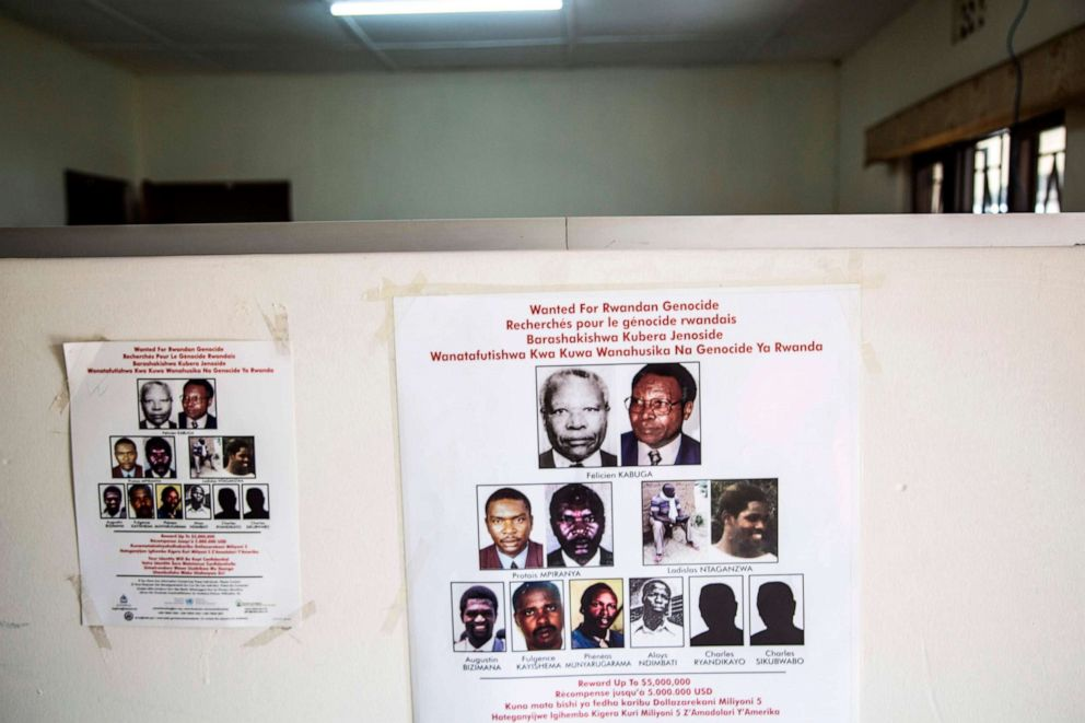 PHOTO: A placard showing names and pictures is stuck on a wall at the headquarters of the Genocide Fugitives Tracking Unit in Kigali, on March 21, 2019.
