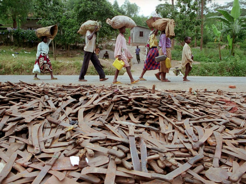 PHOTO: Thousands of abandoned machetes collect at the border of Rwanda and Tanzania, where Hutu refugees fleeing Rwanda are allowed across the border on the condition that they leave behind their weapons in 1994.