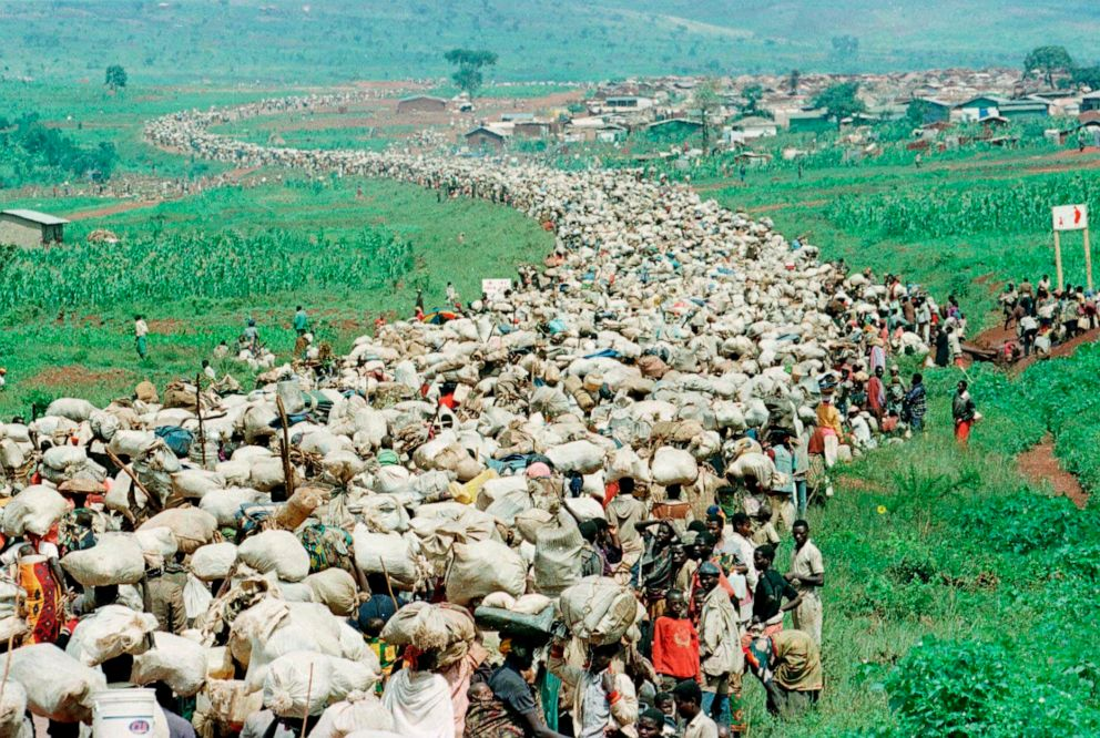 PHOTO: Tens of thousands of Rwandan refugees who were forced by the Tanzanian authorities to return to their country despite fears they will be killed upon their return stream back towards the Rwandan border on a road in Tanzania, Dec. 19, 1996.
