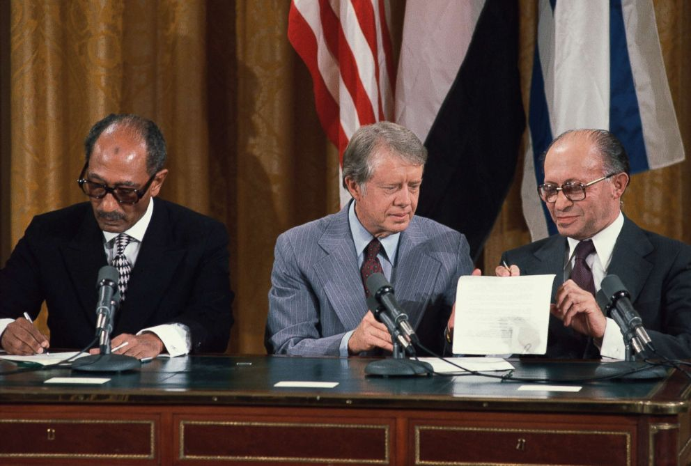 PHOTO: President Jimmy Carter sits between Egyptian President Anwar Sadat (left) and Israeli Prime Minister Menachem Begin at the signing of the preliminary Camp David Accords, at the White House, Sept. 1978 in Washington, D.C.