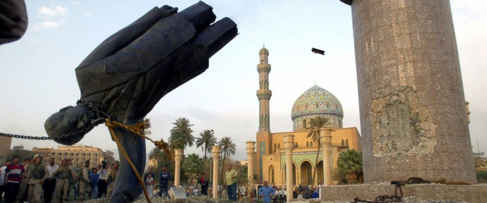 PHOTO: US troops enter central Baghdad and topple the statue of Saddam Hussein, April 9, 2003, in Baghdad, Iraq.