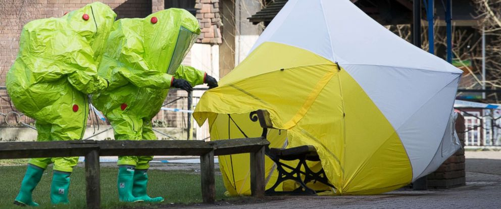 PHOTO: Specialists in protective suits secure the forensic tent on March 8, 2018, that had been blown over by the wind and is covering the bench where Sergei Skripal was found with his daughter after an apparent nerve agent attack, in Salisbury, England.