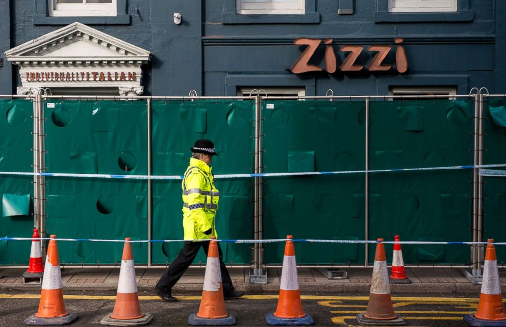 PHOTO: Police officers stand outside Zizzi restaurant as it remains closed as investigations continue into the poisoning of Sergei Skripal on March 11, 2018 in Salisbury, England.