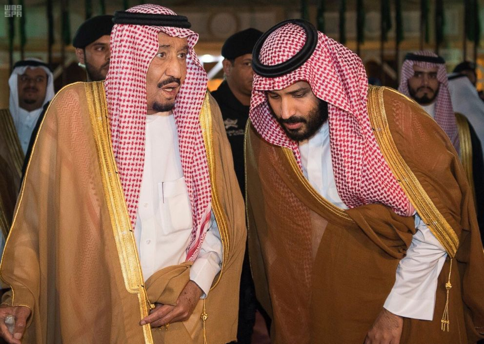 Saudi Arabia's King Salman bin Abdulaziz Al Saud, left, chats with his son and Crown Prince Mohammed bin Salman in Riyadh, Saudi Arabia, Nov. 8, 2017.