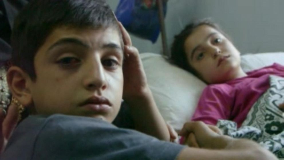 PHOTO: Sara and her brother Ahmed lost their brother Mohammed, who was just 13, in an artillery explosion.