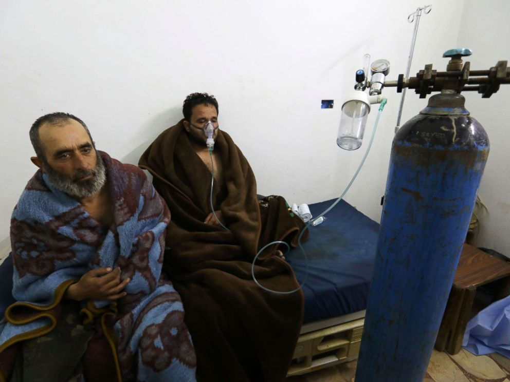 PHOTO: Syrians reportedly suffering from breathing difficulties following Syrian regime air strikes on the northwestern town of Saraqeb, rest at a field hospital in a village on the outskirts of Saraqeb, Feb. 4, 2018.