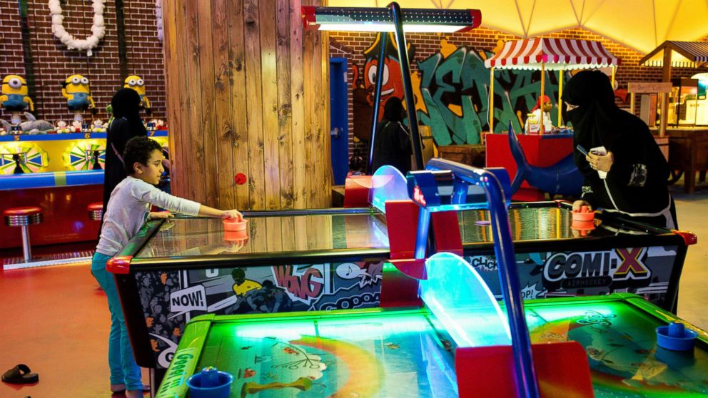 Visitors play air hockey at a indoor family theme park in the Al Yasmin mall in Jeddah, Saudi Arabia, Aug. 6, 2017.