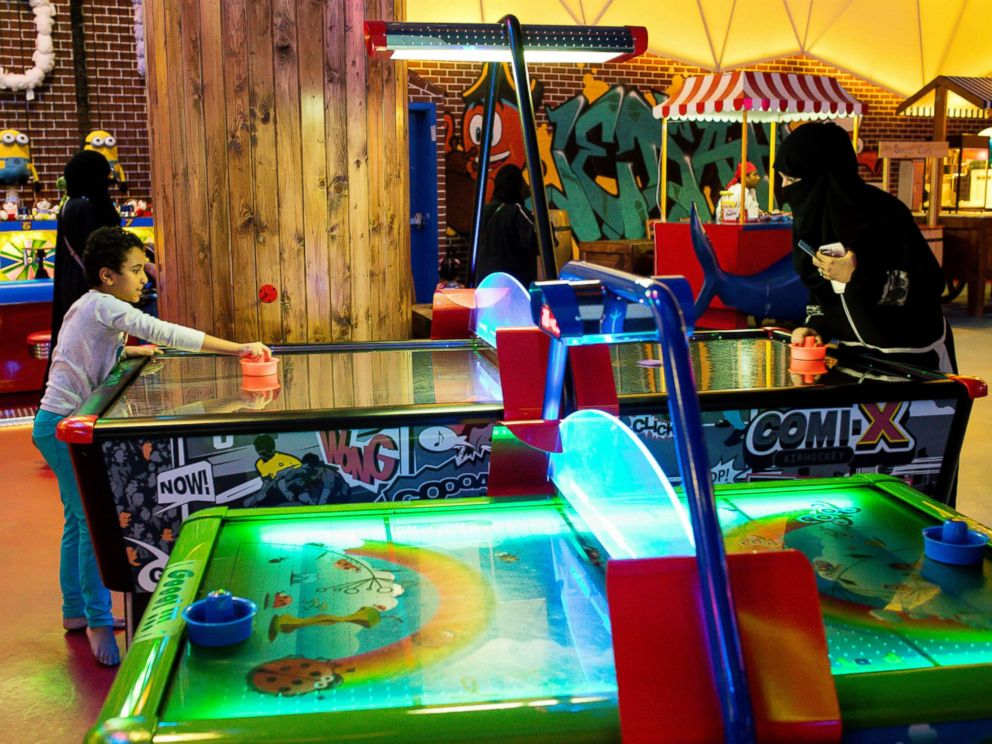 PHOTO: Visitors play air hockey at a indoor family theme park in the Al Yasmin mall in Jeddah, Saudi Arabia, Aug. 6, 2017.