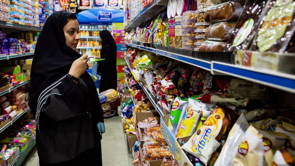 Women browse food products in a grocery store in Jeddah, Saudi Arabia, Aug. 6, 2017.