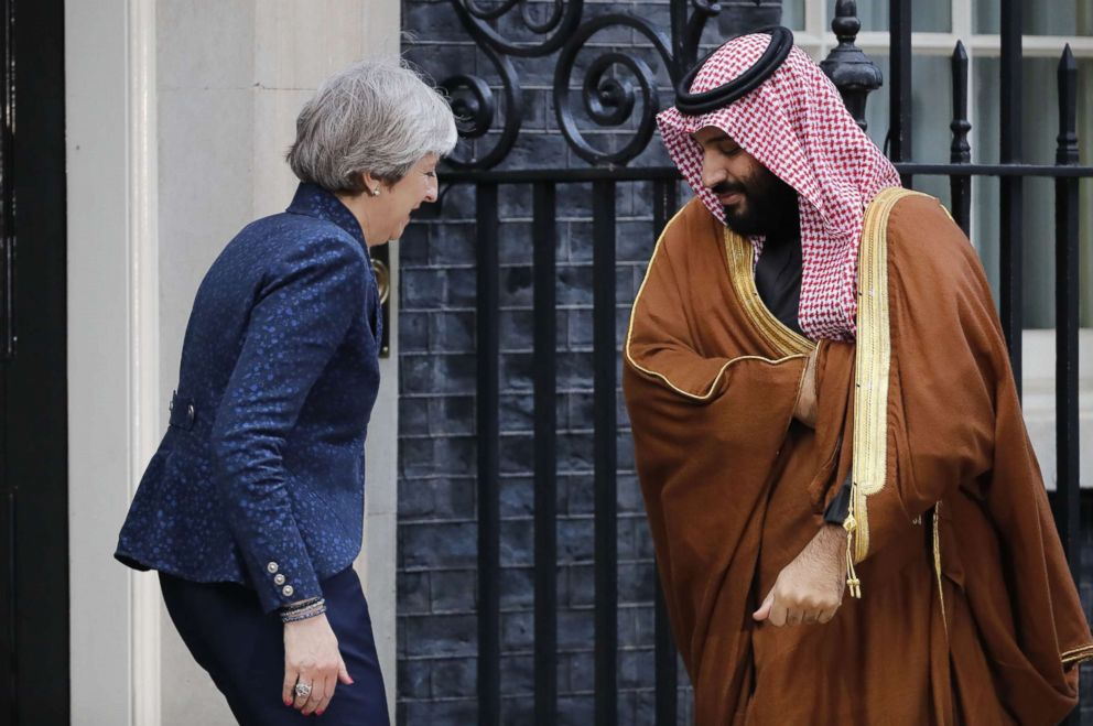 Britain's Prime Minister Theresa May (L) greets Saudi Arabia's Crown Prince Mohammed bin Salman (R) outside 10 Downing Street, in London, March 7, 2018.