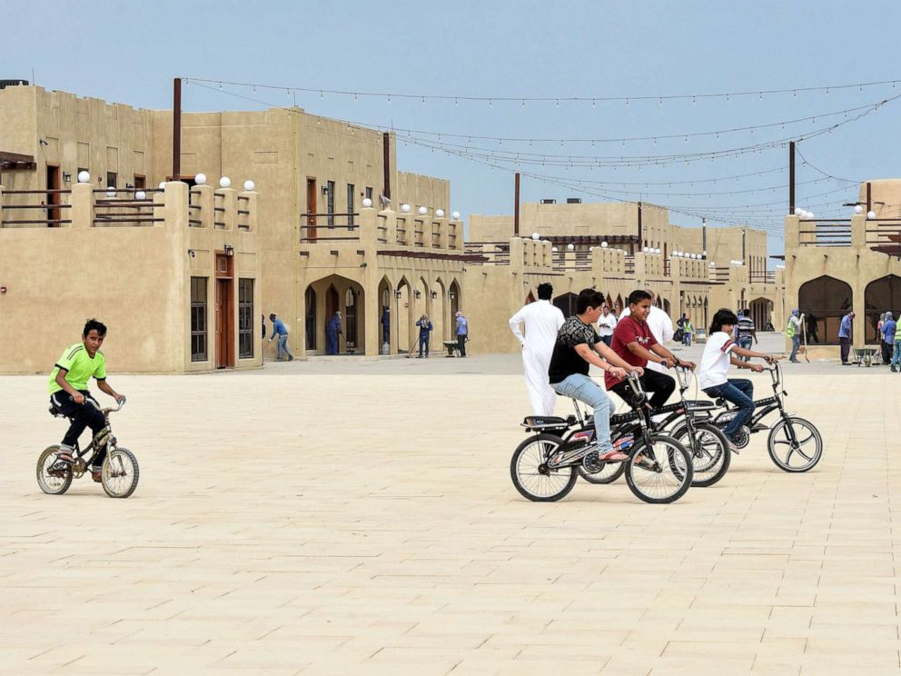 PHOTO: In this file photo, children ride their bicycles at the reconstructed historical quarter of Awamiya, a Shiite-majority town on Saudi Arabias oil-rich eastern coast on April 28, 2019.