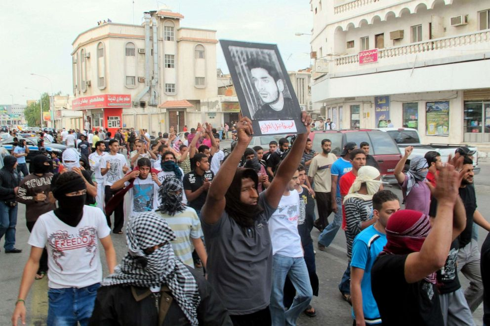 PHOTO: In this file photo, a protester holds a picture of a man said to be held prisoner without trial, during a demonstration in Saudi Arabias eastern Gulf coast town of Qatif, March 11, 2011.