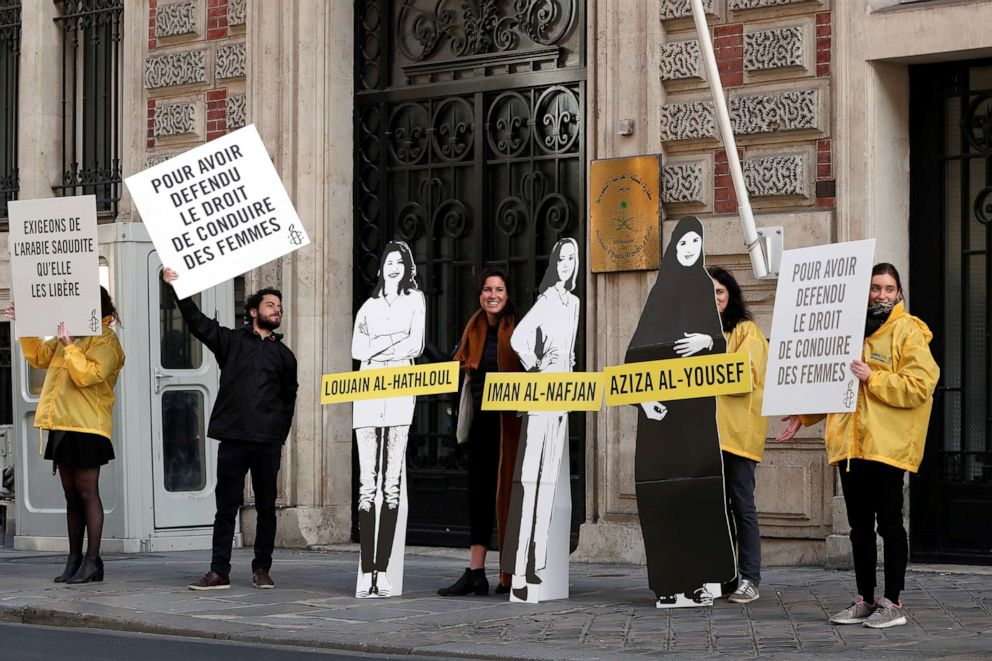 PHOTO: Demonstrators from Amnesty International stage the protest to urge Saudi authorities to release jailed womens rights activists Loujain al-Hathloul, Eman al-Nafjan and Aziza al-Yousef outside the Saudi Arabian Embassy in Paris on March 8, 2019.