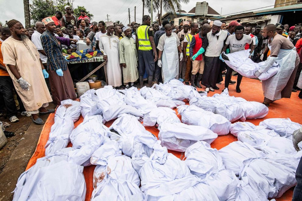PHOTO: After being made ready for burial, men lay one of many bodies who were killed in an overnight fire at a Koranic school, on plastic sheeting as they are prepared for burial, in Monrovia, Sept. 18, 2019.