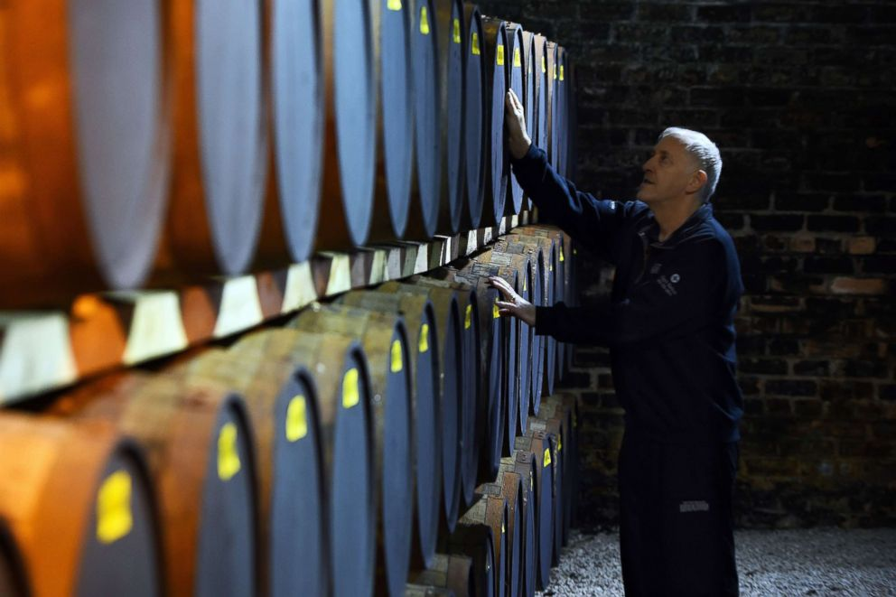 PHOTO: Nigel Baker checks on oak barrels of whisky being stored before bottling, at the Auchentoshan Distillery near Glasgow, Scotland, Feb. 28, 2018.