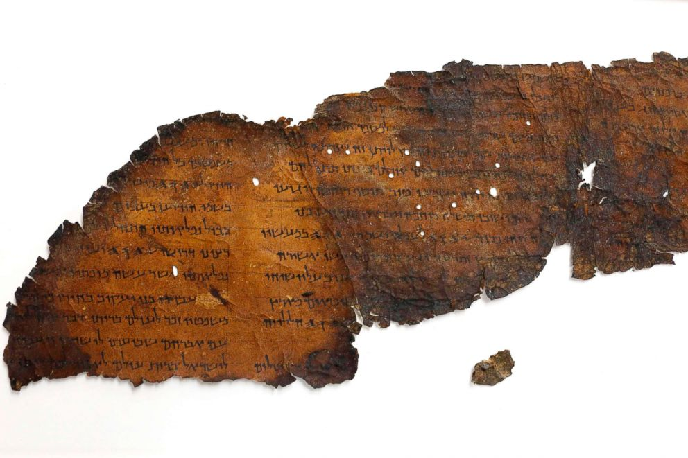 PHOTO: A large fragment of a scroll found in Cave 11 is pictured next to another small fragment which recently with the aid of advanced imaging equipment revealed a previously unseen hidden text.