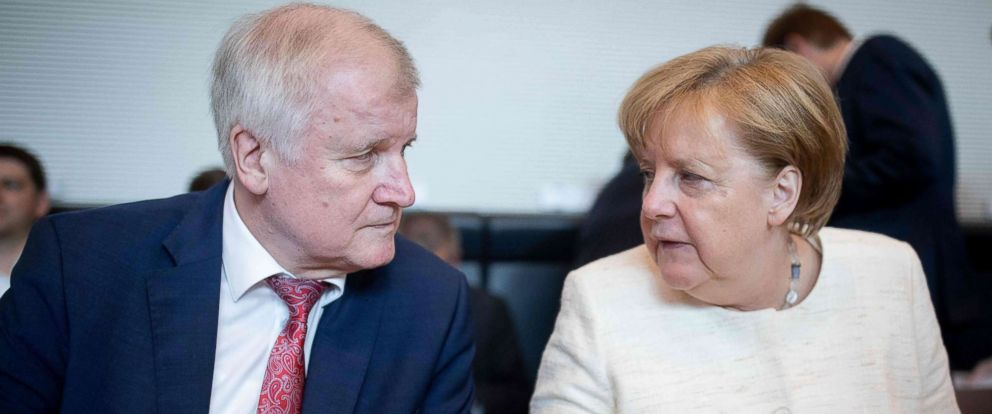 PHOTO: German Chancellor and leader of the Christian Democratic Union (CDU) party Angela Merkel talks with German Interior Minister Horst Seehofer (CSU) prior a parliamentary group meeting, June 12, 2018, in Berlin.