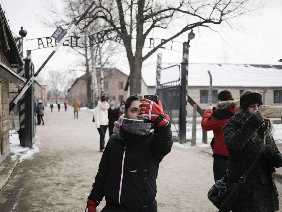 PHOTO: Visitors take selfie photographs near the main gate at the Auscwitz-Birkenau concentration camp museum in Poland, Feb. 28, 2018.