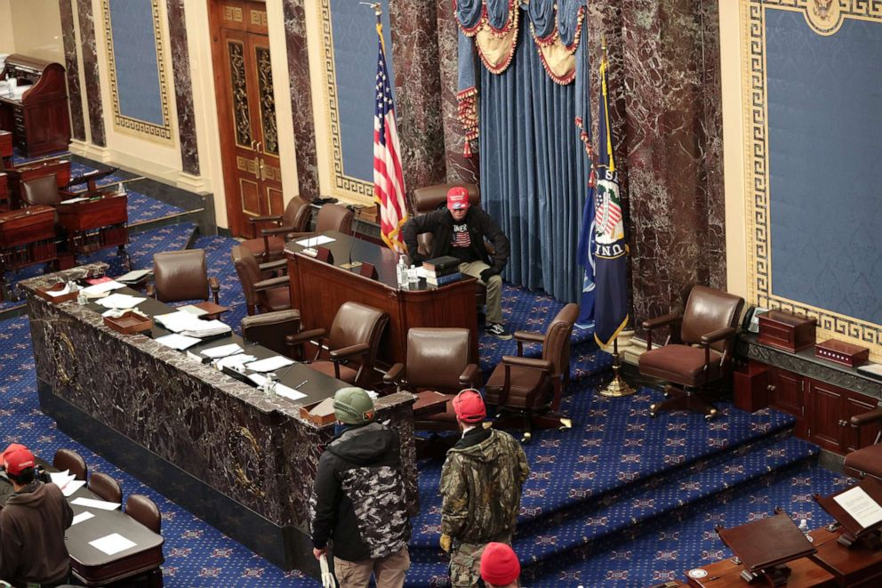 PHOTO: Trump supporters enter the Senate Chamber on Jan. 06, 2021, in Washington, D.C.