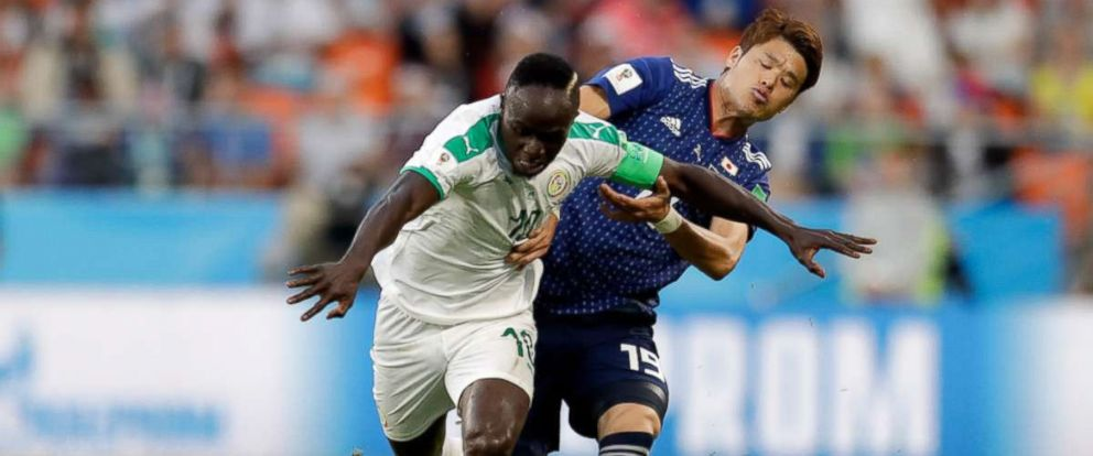 PHOTO: Senegals Ismaila Sarr, left, and Japans Hiroki Sakai fight for the ball during the group H match between Japan and Senegal at the 2018 soccer World Cup at the Yekaterinburg Arena in Yekaterinburg, Russia, June 24, 2018.
