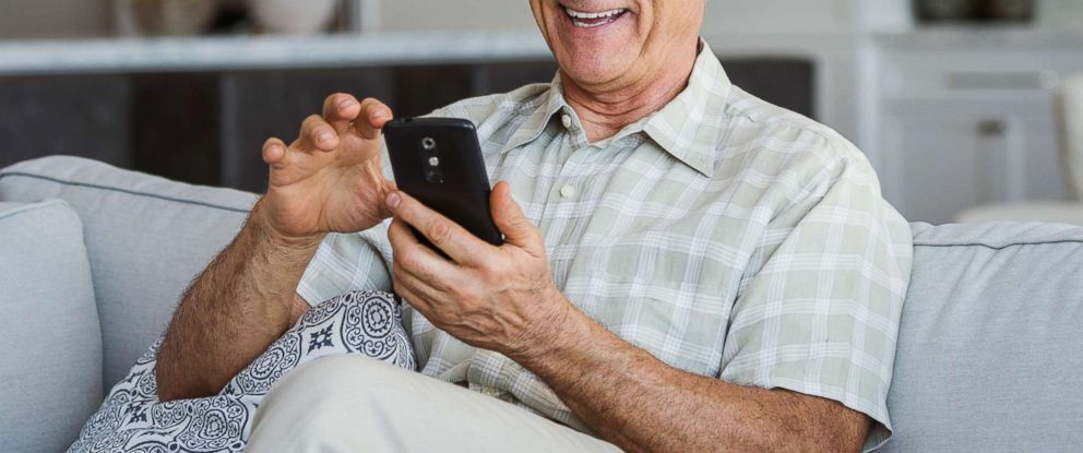 PHOTO: A stock photo depicts a senior man using a smartphone.