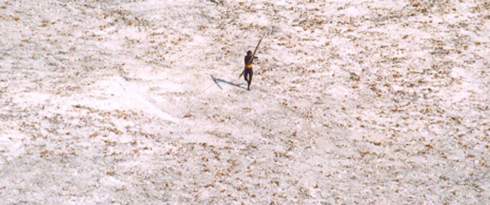 PHOTO: In this file photo a Sentinel tribal man aims with his bow and arrow at an Indian Coast Guard helicopter as it flies over the island for a survey of the damage caused by the tsunami in Indias Andaman and Nicobar archipelago, Dec. 28, 2004.