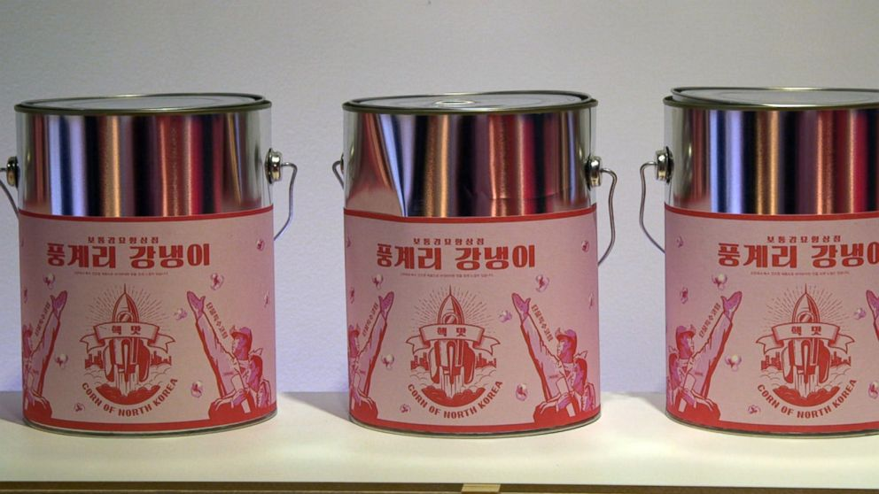 "Tin cases covered in pink stickers are filled with ""Punggye-ri popcorn,"" named after a nuclear site in North Korea."