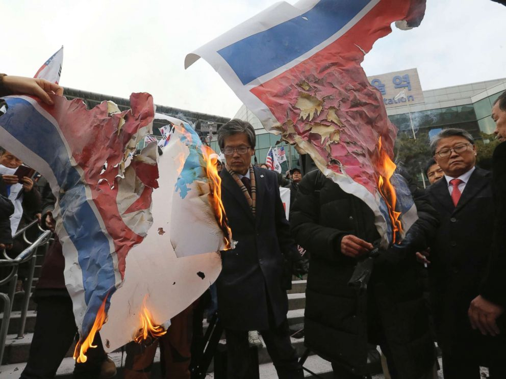 PHOTO: South Korean protesters burn a North Korean and Unification flag during a rally against a visit of North Korean Hyon Song Wol, head of a North Korean art troupe, in front of Seoul Railway Station in Seoul, South Korea, Jan. 22, 2018.