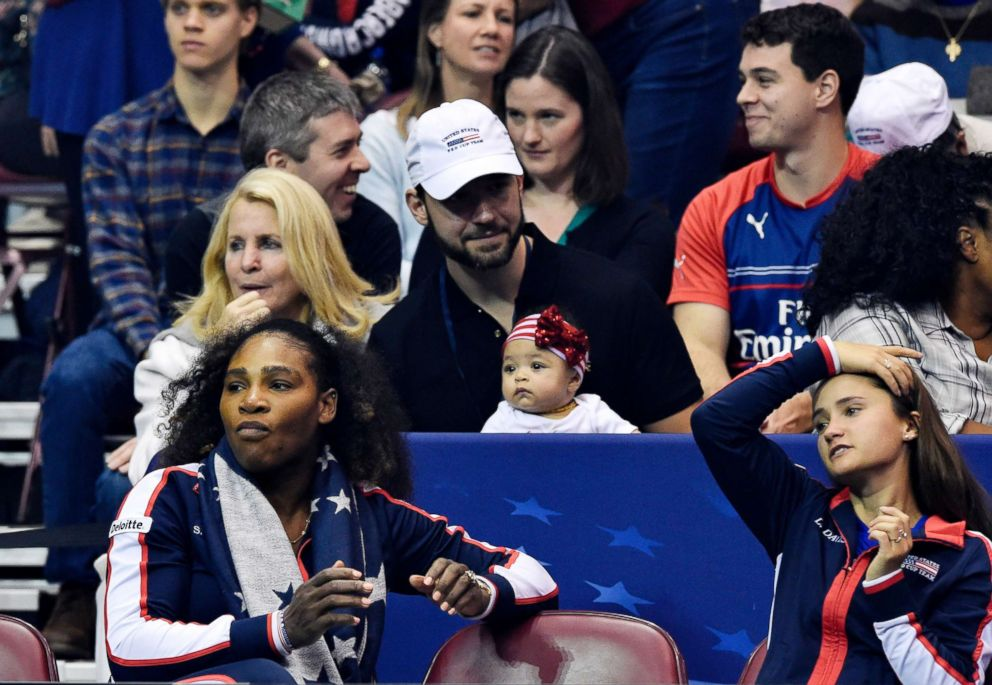 PHOTO: Serena Williams, bottom left, along with her husband Alexis Ohanian and their daughter Alexis Olympia, center, watch the action during the first round of the 2018 Fed Cup at US Cellular Center, Feb. 10, 2018, in Asheville, N.C.