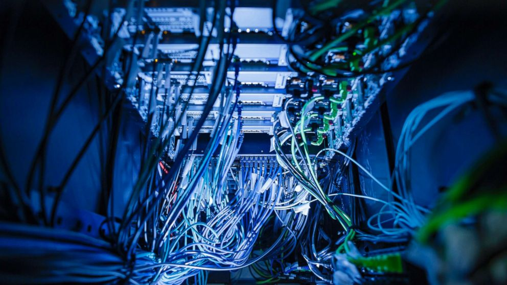 Cables and LED lights in a server center in Berlin, Germany, Jan. 12, 2018.