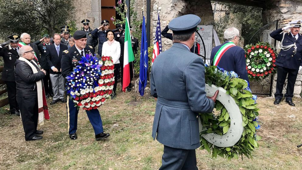Local dignitaries, international residents and military authorities at the commemorative ceremony at Montebuono, Italy.