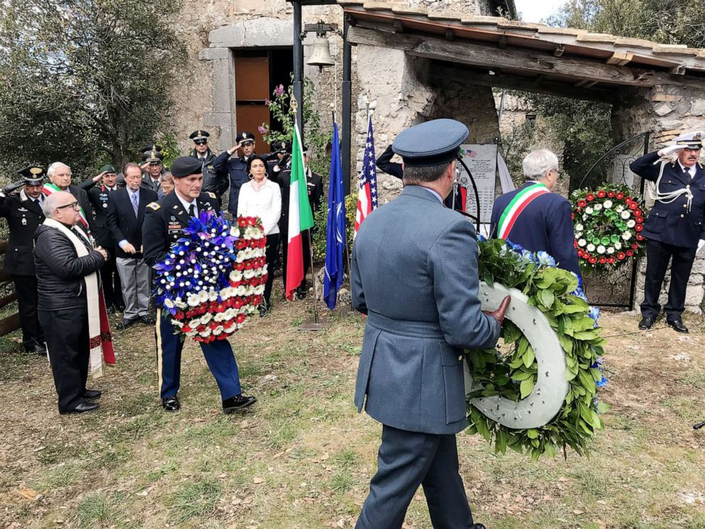 PHOTO: Local dignitaries, international residents and military authorities at the commemorative ceremony at Montebuono, Italy.