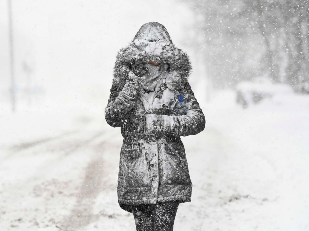 Jeff J. Mitchell  Getty ImagesA woman makes her way through the snow