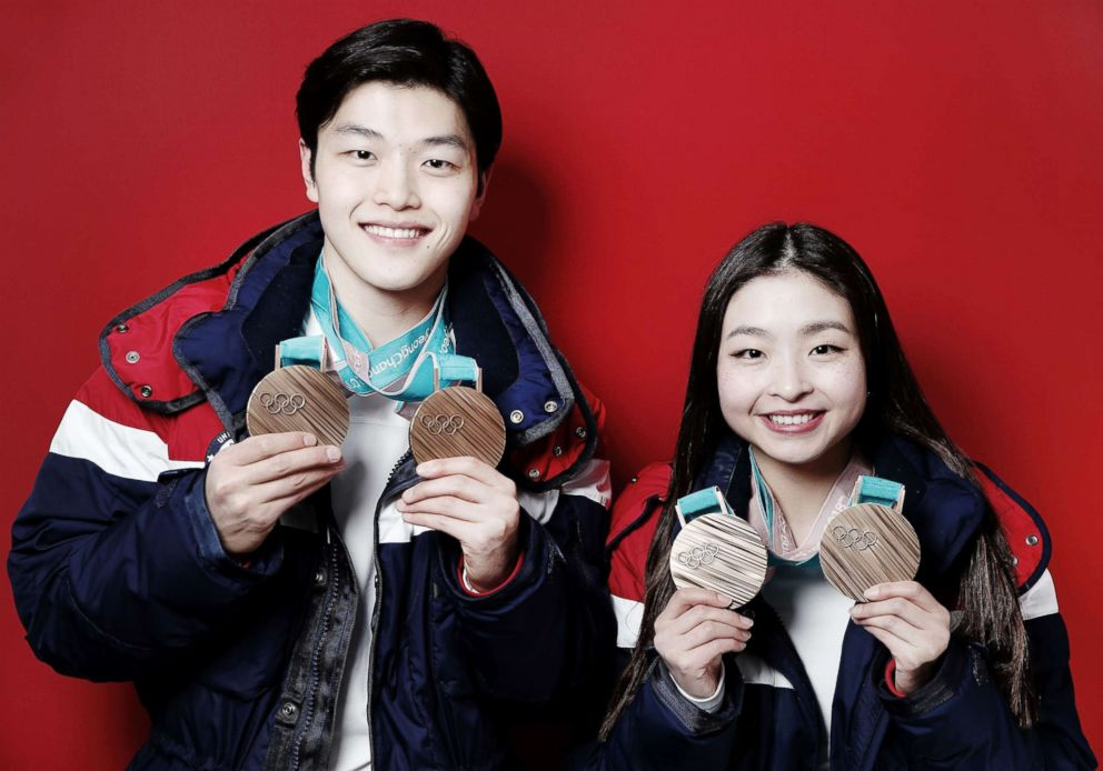 PHOTO: American figure skaters and siblings Maia Shibutani and older brother Alex Shibutani pose for a portrait with their bronze medals, one for the team event and one for the ice dance event, Feb. 20, 2018, in Gangneung, South Korea.