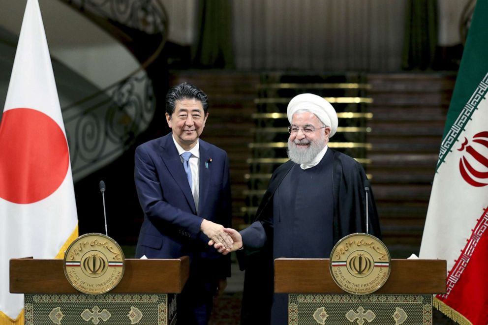 PHOTO: Japanese Prime Minister Shinzo Abe, left, and Iranian President Hassan Rouhani shake hands after their joint press conference at the Saadabad Palace in Tehran, Iran, June 12, 2019.