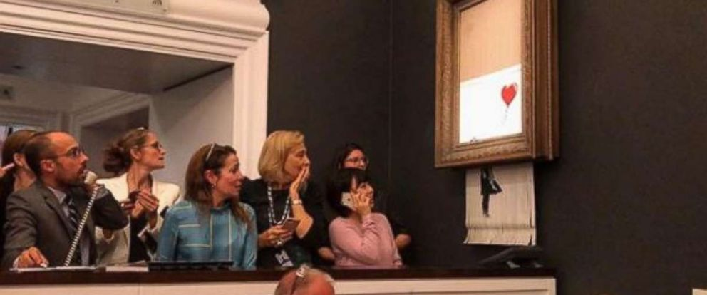 """PHOTO: Banksys work """"Girl with Balloon"""" was timed to be fed through a shredder seconds after being auctioned at Sothebys for $1.4 million in London on Friday, Oct. 5, 2018."""
