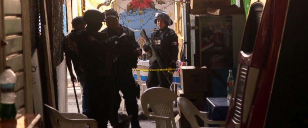 PHOTO: Mexican authorities access a homicide scene in Acapulco where a food stand owner was shot and killed.